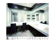 黒と白のモノトーンのモダンなトイレ